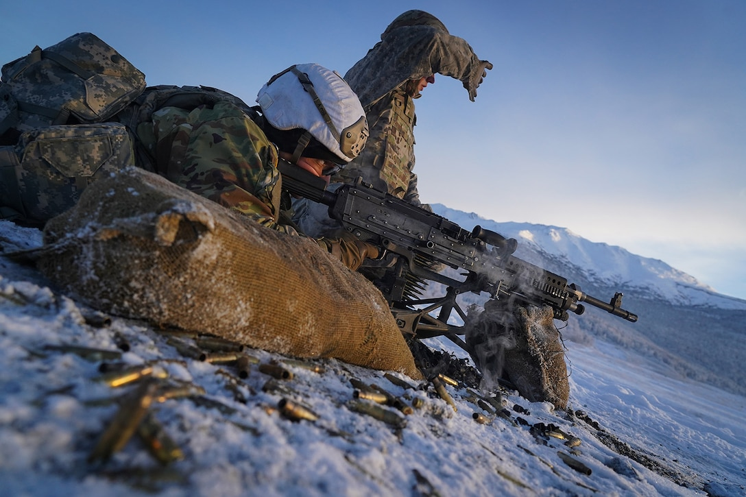Army Pfc. John Paul Petrenko, a native of Jamaica, N.Y., fires an M240B machine gun as his assistant gunner Army Pfc. Blade Briscoe, a native of Fort Drum, N.Y., spots targets while the Soldiers, both assigned to the 2nd Battalion, 377th Parachute Field Artillery Regiment, 4th Infantry Brigade Combat Team (Airborne), 25th Infantry Division, U.S. Army Alaska, conduct live-fire qualification at Grezelka range, on Joint Base Elmendorf-Richardson, Alaska, Dec. 5, 2019. The Soldiers practiced identifying, and engaging targets at varying distances to solidify their proficiency with the weapons in sub-arctic conditions.