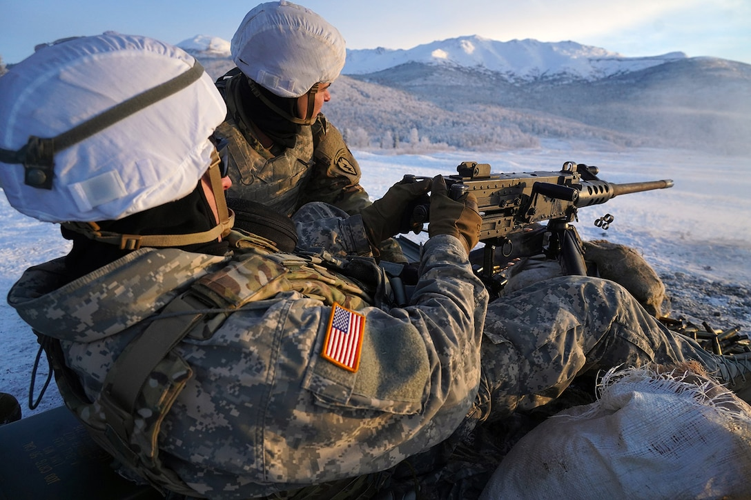 Paratroopers assigned to the 2nd Battalion, 377th Parachute Field Artillery Regiment, 4th Infantry Brigade Combat Team (Airborne), 25th Infantry Division, U.S. Army Alaska, fire an M2 machine gun while conducting live-fire qualification at Grezelka range, on Joint Base Elmendorf-Richardson, Alaska, Dec. 5, 2019. The Soldiers practiced identifying, and engaging targets at varying distances to solidify their proficiency with the weapons in sub-arctic conditions.