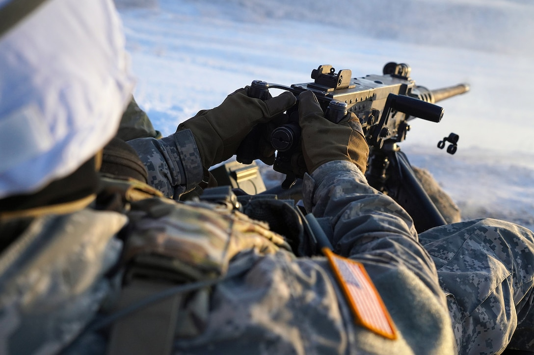 A paratrooper assigned to the 2nd Battalion, 377th Parachute Field Artillery Regiment, 4th Infantry Brigade Combat Team (Airborne), 25th Infantry Division, U.S. Army Alaska, fires an M2 machine gun while conducting live-fire qualification at Grezelka range, on Joint Base Elmendorf-Richardson, Alaska, Dec. 5, 2019. The Soldiers practiced identifying, and engaging targets at varying distances to solidify their proficiency with the weapons in sub-arctic conditions.