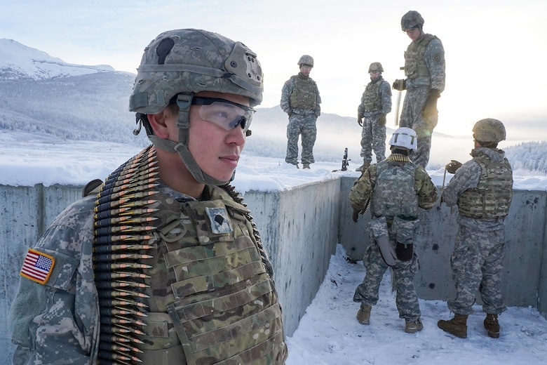 Spc. Ben Clarke, a native of Doylestown, Pa., assigned to the 2nd Battalion, 377th Parachute Field Artillery Regiment, 4th Infantry Brigade Combat Team (Airborne), 25th Infantry Division, U.S. Army Alaska, waits for his turn to fire an M240B machine gun while conducting live-fire qualification at Grezelka range, on Joint Base Elmendorf-Richardson, Alaska, Dec. 5, 2019. The Soldiers practiced identifying, and engaging targets at varying distances to solidify their proficiency with the weapons in sub-arctic conditions.