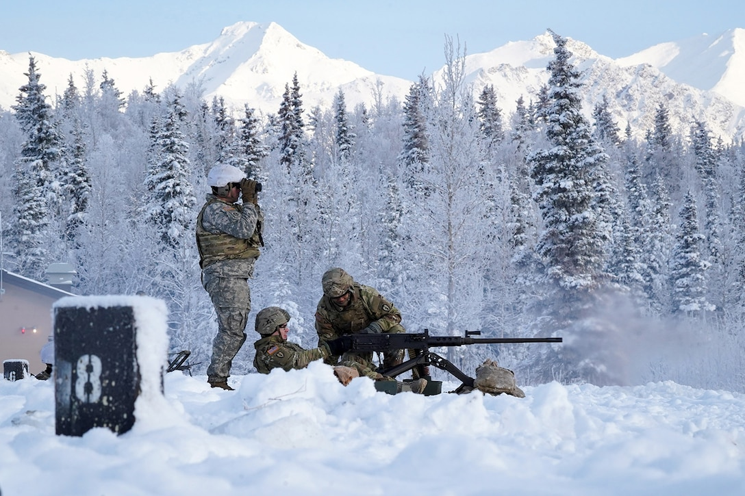 Army Staff Sgt. Tyler Hall, a native of Orlando, Fla., assigned to the 2nd Battalion, 377th Parachute Field Artillery Regiment, 4th Infantry Brigade Combat Team (Airborne), 25th Infantry Division, U.S. Army Alaska, spots targets downrange as two of his Soldiers fire an M2 machine gun while conducting live-fire qualification at Grezelka range, on Joint Base Elmendorf-Richardson, Alaska, Dec. 5, 2019. The Soldiers practiced identifying, and engaging targets at varying distances to solidify their proficiency with the weapons in sub-arctic conditions.