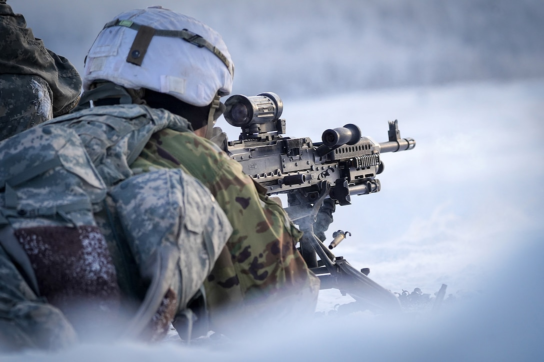 A paratrooper assigned to the 2nd Battalion, 377th Parachute Field Artillery Regiment, 4th Infantry Brigade Combat Team (Airborne), 25th Infantry Division, U.S. Army Alaska, fires an M240B machine gun while conducting live-fire qualification at Grezelka range, on Joint Base Elmendorf-Richardson, Alaska, Dec. 5, 2019. The Soldiers practiced identifying, and engaging targets at varying distances to solidify their proficiency with the weapons in sub-arctic conditions.
