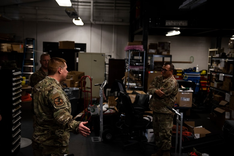 U.S. Air Force Staff Sgt. Christopher Kiebach, 325th Operations Support Squadron Radar, Airfield, and Weather supervisor, left, briefs U.S. Air Force Col, Brian Laidlaw, 325th Fighter Wing commander, center, and U.S. Air Force Tech. Sgt. Richard Oliver, 325th OSS RAWS noncommissioned officer in charge at Tyndall Air Force Base, Florida, Nov. 26, 2019. Kiebach have a tour of the unit's work center to Laidlaw, discussed manning, operations, and the status for new and old equipment used for the base's mission. (U.S. Air Force photo by Staff Sgt. Magen M. Reeves)