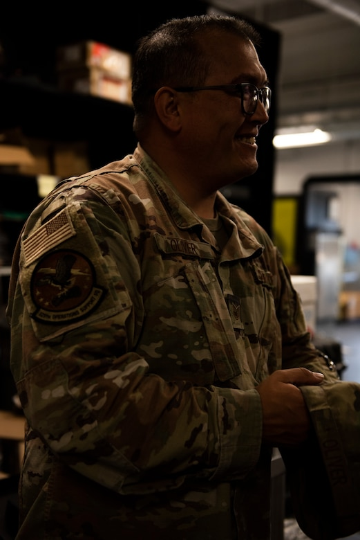 U.S. Air Force Tech. Sgt. Richard Oliver, 325th Operations Support Squadron Radar, Airfield, and Weather System noncommissioned in charge participates in a briefing at Tyndall Air Force Base, Florida, Nov. 26, 2019. Oliver and his team of Airmen maintain air traffic and control systems for Tyndall including all means of communication from air traffic controllers to aircraft operators via radio, as well as interagency communication via telephones. (U.S. Air Force photo by Staff Sgt. Magen M. Reeves)