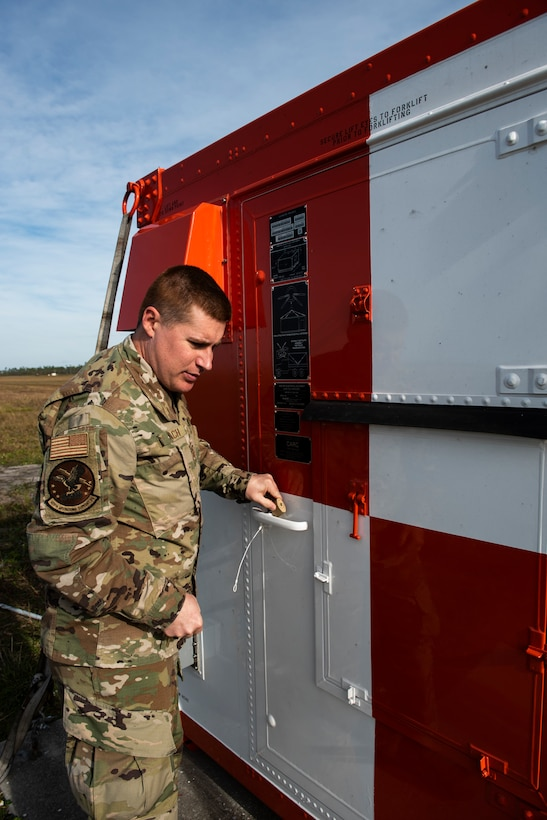 U.S. Air Force Staff Sgt. Christopher Kiebach, 325th Operations Support Squadron Radar, Airfield, and Weather Systems supervisor, locks up a critical resource at Tyndall Air Force Base, Florida, Nov. 26, 2019. Kiebach, originally from Sierra Vista, Arizona, was selected to represent the 325th Operations Group during the month's Airman Shadow program, which embeds with wing commander into a unit to see how Airmen perform day-to-day duties in support of the 325th Fighter Wing mission. (U.S. Air Force photo by Staff Sgt. Magen M. Reeves)