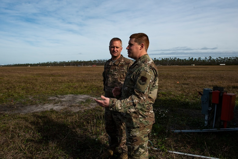 U.S. Air Force Col. Brian Laidlaw, 325th Fighter Wing commander, left, talks to U.S. Air Force Staff Sgt. Christopher Kiebach, 325th Operations Support Squadron Radar, Airfield, and Weather Systems supervisor at Tyndall Air Force Base, Florida, Nov. 26, 2019. Kiebach and his team maintain air traffic and control systems for Tyndall including all means of communication from air traffic controllers to aircraft operators via radio, as well as interagency communication via telephones. (U.S. Air Force photo by Staff Sgt. Magen M. Reeves)