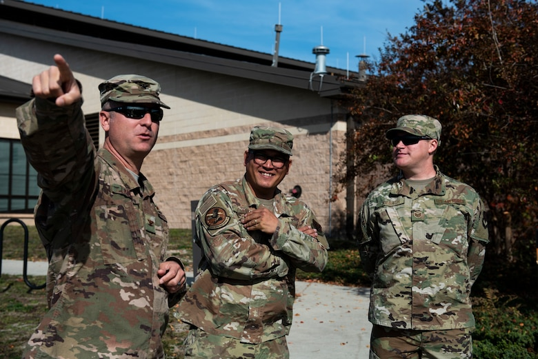 U.S. Air Force Col. Brian Laidlaw, 325th Fighter Wing commander, left, points toward a location with U.S. Air Force Tech. Sgt. Richard Oliver, 325th Operations Support Squadron Radar, Airfield, and Weather Systems noncommissioned officer in charge, center, and U.S. Air Force Staff Sgt. Christopher Kiebach, 325th OSS RAWS supervisor at Tyndall Air Force Base, Florida, Nov. 26, 2019. Kiebach had been selected by the 325th Operations Group to showcase his duty specialty to the wing commander as part of the wing's Airman Shadow program. (U.S. Air Force photo by Staff Sgt. Magen M. Reeves)