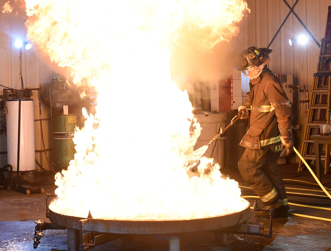 A person douses a  fire.
