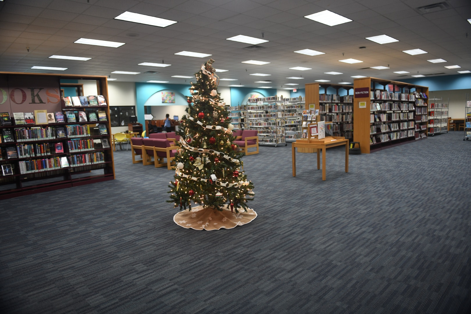 """A view of the main area from the entrance of the library at Joint Base San Antonio-Randolph, Texas, Dec. 5, 2019. """"We'll be getting new sofas, chairs, tables and study carrels in addition to new shelving,"""" said Diana Lisenbee, supervisory librarian. """"It's a way to refresh our space. We want to make sure everything is done right."""""""