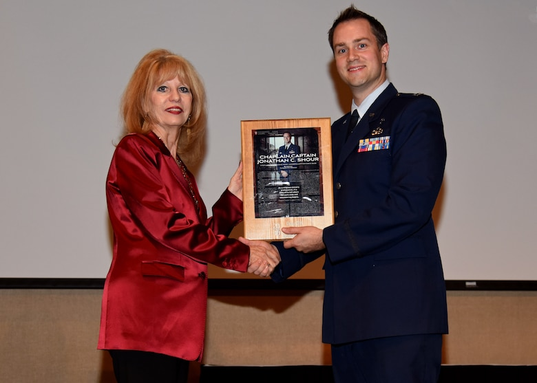 San Angelo Mayor Brenda Gunter presents U.S. Air Force Capt. Johnathan Shour, 17th Training Wing chaplain, with a plaque to congratulate him on being one of 20 selected nominees for 20 Under 40 San Angelo at the McNease Convention Center in San Angelo, Texas, December 5, 2019. The 20 selectees were from all walks of life including lawyers, doctors, and school teachers. (U.S. Air Force photo by Airman 1st Class Ethan Sherwood)