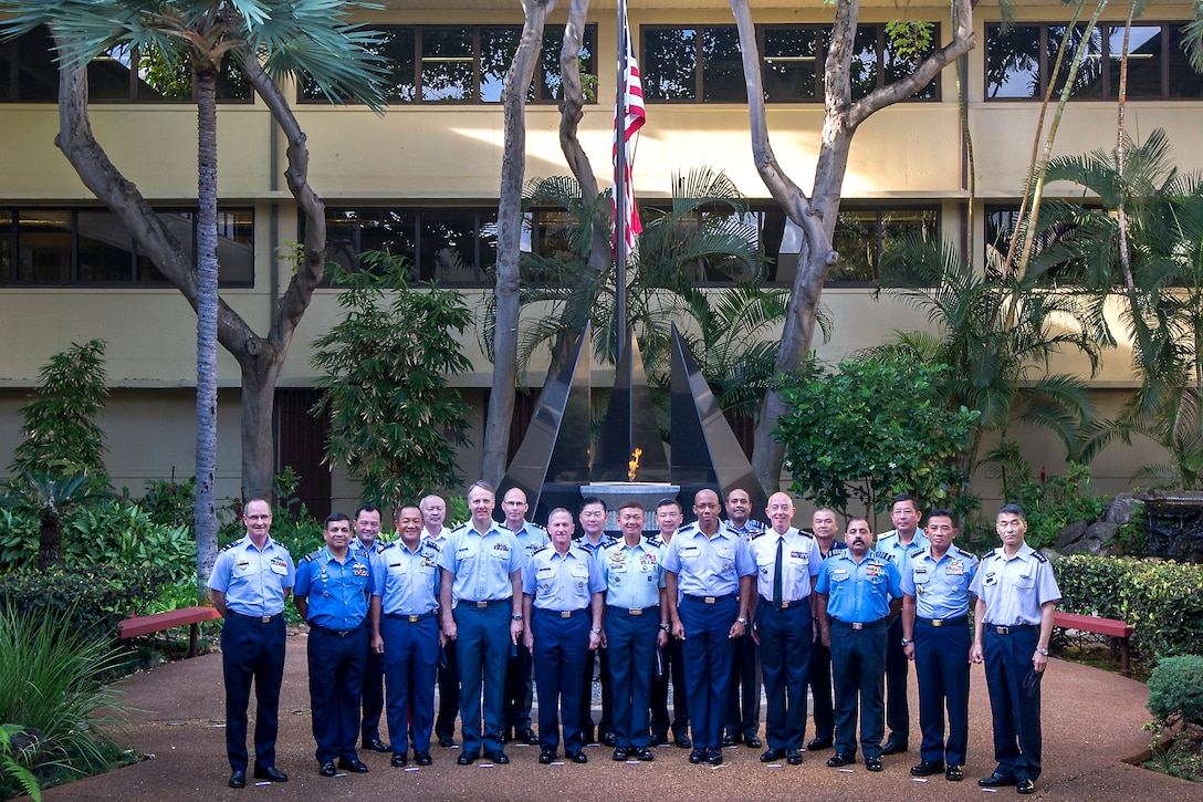 Air chiefs from across the Indo-Pacific pose for a group photo during the 2019 Pacific Air Chiefs Symposium on Joint Base Pearl Harbor-Hickam, Hawaii, Dec. 5, 2019.
