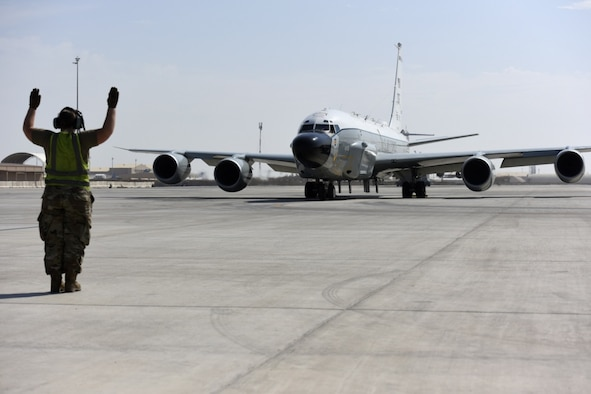 A crew chief assigned to the 763rd Expeditionary Reconnaissance Squadron directs a RC-135 Rivet Joint from its parking area in preparation for a mission at Al Udeid Air Base, Qatar on Nov. 21, 2019. The 763 ERS celebrated 29 years of Rivet Joint deployment in the U.S. Air Forces Central Command area of responsibility during a ceremony on Nov. 23.