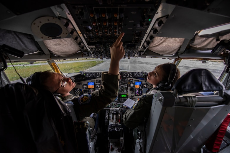 Capt. Grant Starkweather and Capt. Jori Ingersoll, 351st Air Refueling Squadron pilots, conduct pre-flight checks aboard a KC-135 Stratotanker at RAF Mildenhall, England, Nov. 14, 2019. The pilots flew an aerial refueling mission in support of Exercise Point Blank. (U.S. Air Force photo by Airman 1st Class Joseph Barron)