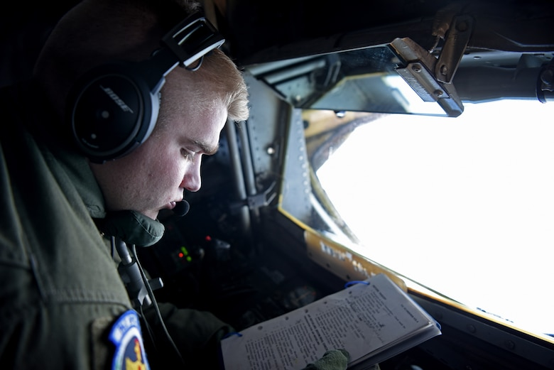 U.S. Air Force Airman 1st Class Alex Bengel, 351st Air Refueling Squadron boom operator, performs aerial refueling checklist during exercise Astral Knight over the skies of Italy, June 3, 2019. AK19 is a joint, multinational exercise designed to test Integrated Air and Missile Defense capabilities and will involve a combination of flight operations and computer-assisted exercise scenarios. Participants include the U.S. Air Forces in Europe, U.S. Army Europe forces, and members from the Italian and Croatian air forces. (U.S. Air Force photo by Airman 1st Class Brandon Esau)