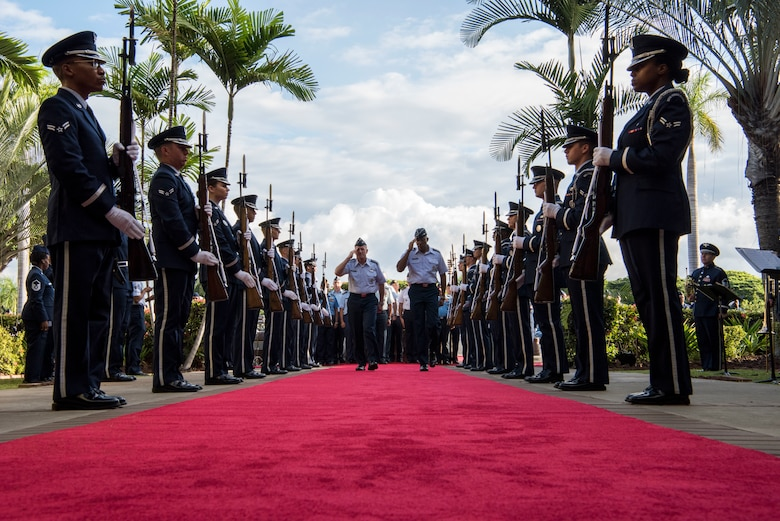 U.S. Air Force Chief of Staff Gen. David L. Goldfein and Gen. CQ Brown, Jr., Pacific Air Forces commander, walk through the 2019 Pacific Air Chiefs Symposium Honor Cordon on Joint Base Pearl Harbor-Hickam, Hawaii, Dec. 5, 2019.