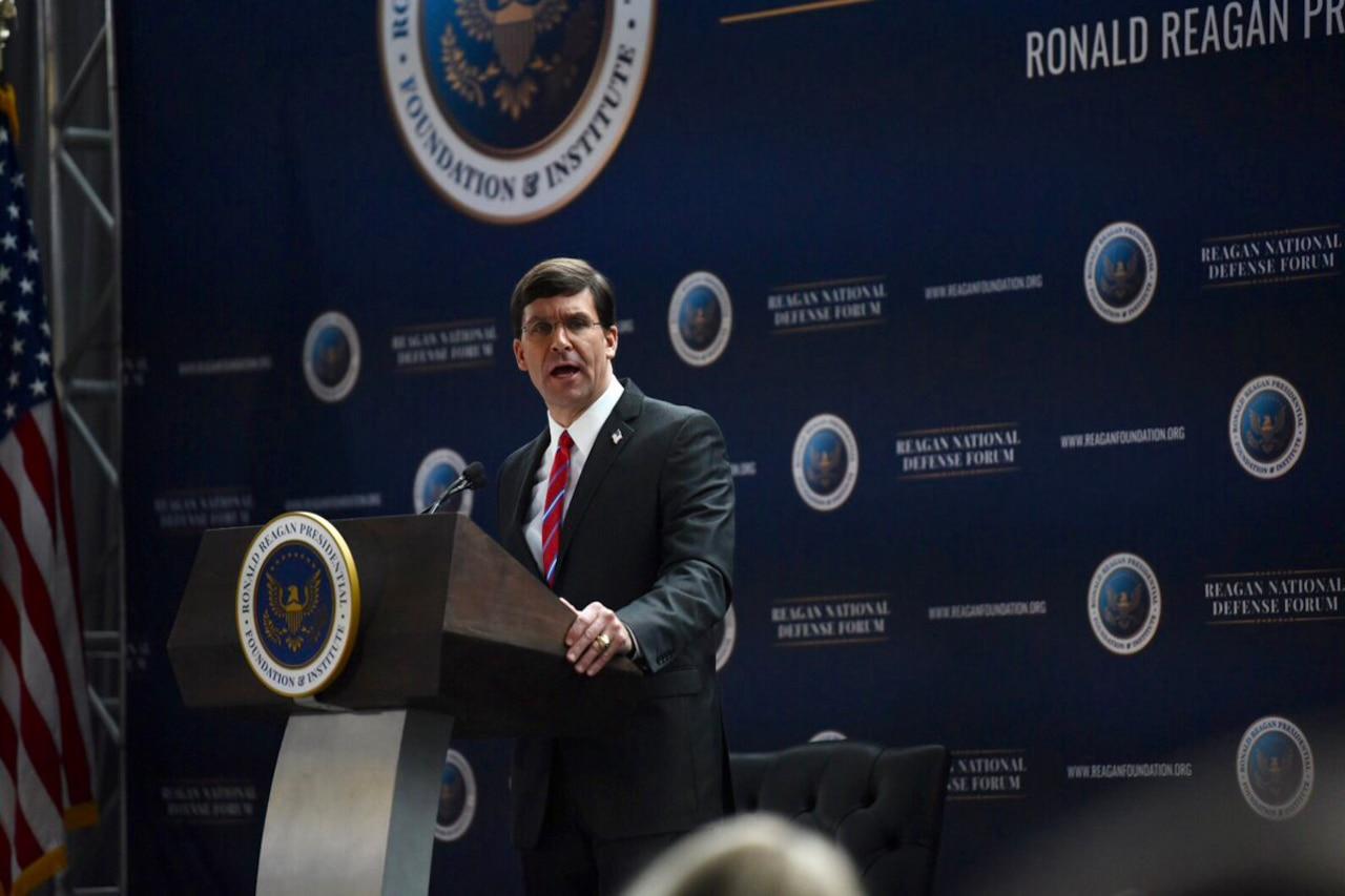 Defense Secretary Dr. Mark T. Esper speaks at a lectern.