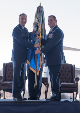Col. Adam Willis, right, incoming 315th Airlift Wing commander, takes command during a change of command ceremony officiated by Maj. Gen. Randall Ogden, left, U.S. Air Force 4th Air Force Commander, at Nose Dock 2 here, Dec. 7. Willis replaced Col. Gregory Gilmour, right, as the 315th Airlift Wing commander.