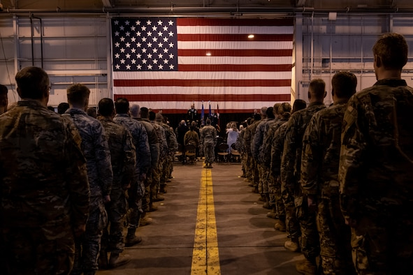 Members of the 137th Special Operations Wing stand at attention and observe as Master Sgt. Bryan Whittle, assigned to the 205th Engineering and Installation Squadron, is presented with the Airman's Medal during a ceremony at Will Rogers Air National Guard Base in Oklahoma City, Dec. 8, 2019. The Airman's Medal is the highest noncombat award given in the Air Force and awarded to service members who distinguish themselves by a heroic act, usually at the voluntary risk of their own life. (U.S. Air National Guard photo by Staff Sgt. Brigette Waltermire)