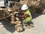 Navy Petty Officer Second Class Jhunar Medenilla, a new PACE member, performs an ammo abatement inspection on a vehicle during his recent deployment to DLA Disposition Services site at Bagram Airfield, Afghanistan.