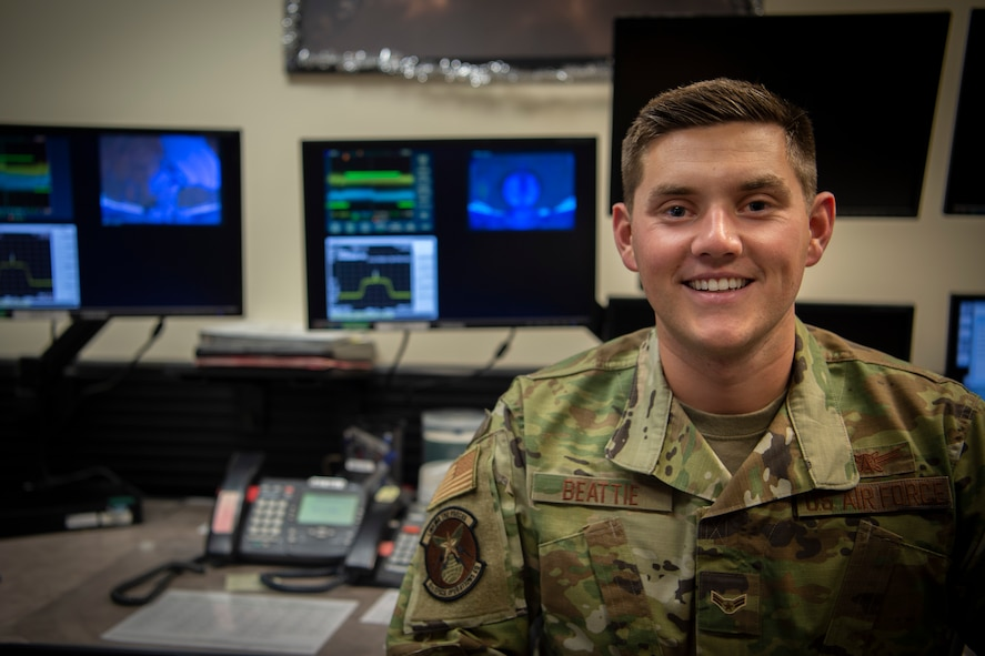 Airman 1st Class William Beattie, 4th Space Operations Squadron Advanced Extremely High Frequency satellite mission control sub-systems operator, sent the first command to the new AEHF-5 satellite Nov. 23, 2019, at Schriever Air Force Base, Colorado. Despite being an Airman First Class, Beattie was able to send the first command, impacting warfighters across the world. (U.S. Air Force photo by Airman 1st Class Jonathan Whitely)