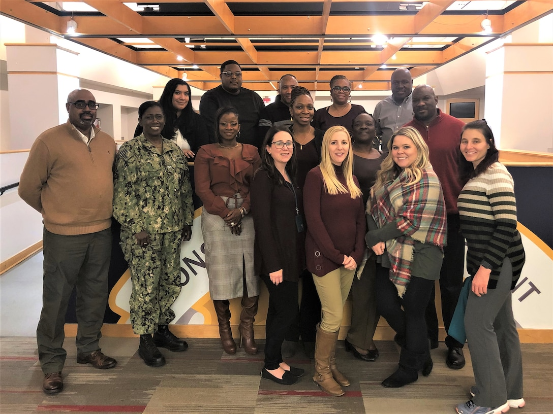 Members of the Construction and Equipment supply chain's Culture Improvement Team pose with Capt. Jacqueline Meyer, the supply chain director, during the group's holiday luncheon. The event was held Dec. 5, 2019 at the Defense Logistics Agency Troop Support Headquarters in Philadelphia.