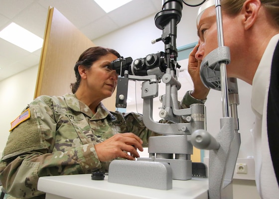Col. Adrienne Ari, an optometrist at Landstuhl Regional Medical Center in Germany, performs an eye examination Sept. 19, 2019. In October 2018, the Army, Navy and Air Force started the process to transfer the administration and management of their military medical treatment facilities to DHA. Phase II of that transition was completed this fall with roughly half of the MTFs in the continental U.S. now under the DHA. All other hospitals and clinics, including those overseas, will follow suit by 2021.