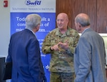 Lt. Col. Eddie K. Stamper (center), Joint Base San Antonio-Electromagnetic Defense Initiative project officer, speaks with J.O. McFalls, McFalls Associates LLC, and Klaus Weiswurm, Innovation Technology Machinery chairman and an appointee to the U.S. Air Force Civic Leader Program, before the quarterly San Antonio Electromagnetic Defense meeting at Southwest Research Center Nov. 18.