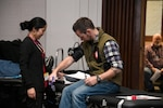 An employee has his blood pressure checked while participating in the Dec. 4 American Red Cross blood drive at the Hart-Dole-Inouye Federal Center.