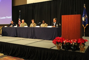 """(from left) Brig. Gen. Paul Friedrichs, Joint Staff Surgeon, Joint Chiefs of Staff, Rear Adm. Bruce Gillingham, Navy Surgeon General, Lt. Gen. Dorothy Hogg, Air Force Surgeon General, Maj. Gen. Telita Crosland, Army Deputy Surgeon General, and Mr. Guy Kiyokawa, Deputy Director, Defense Health Agency, speak at the Air Force Medical Service 2019 Senior Leadership Workshop in Leesburg, Virginia, Dec. 3, 2019. The panel discussed the importance of embracing change and focusing on becoming an even more medically ready force. """"As the Military Health System evolves, it is important that we are all moving in the same direction,"""" said Hogg. (U.S. Air Force photo by Josh Mahler)"""