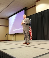 """U.S. Air Force Senior Master Sgt. (Ret) Israel Del Toro speaks at the at the Air Force Medical Service 2019 Senior Leadership Workshop in Leesburg, Virginia, Dec. 4, 2019. Fourteen years ago, Del Toro was injured in a blast that caused third degree burns on 80% of his body. Del Toro shared how his burns made him stronger. """"Every time I got knocked down, I didn't get up on my own. I had teammates who were there to help me back up,"""" said Del Toro. (U.S. Air Force photo by Josh Mahler)"""