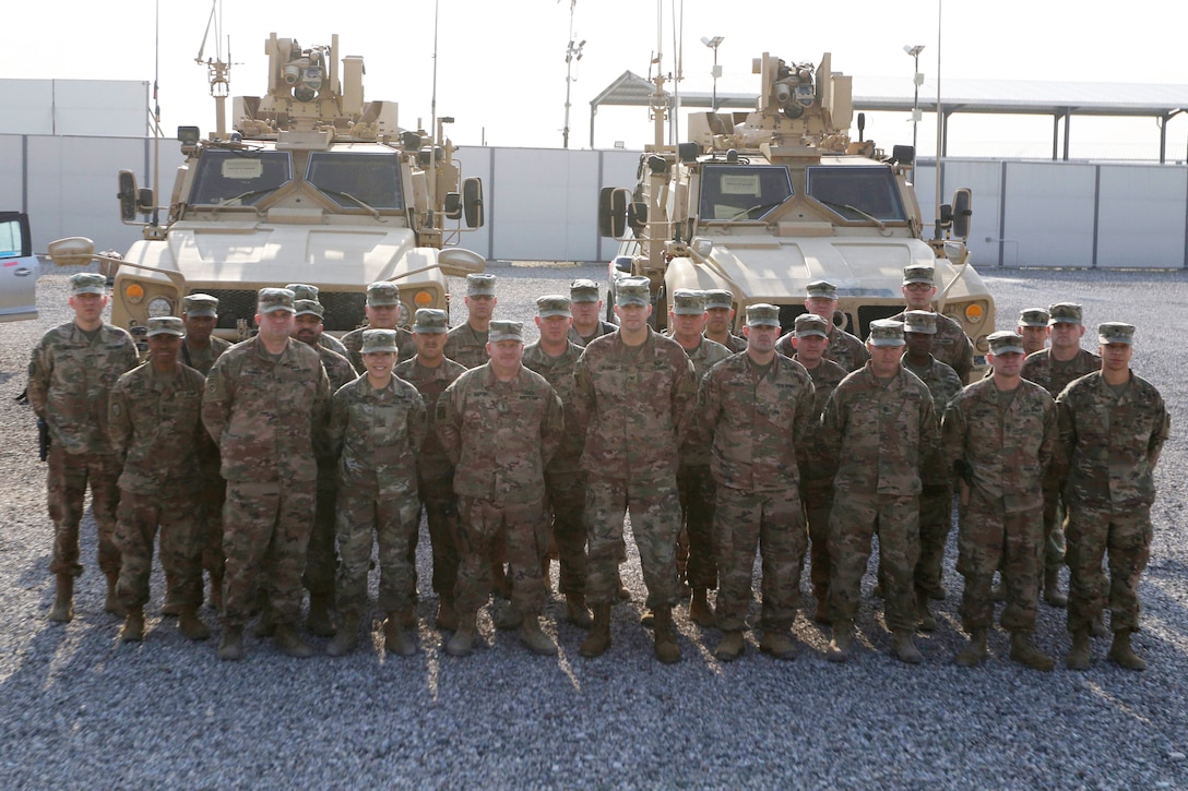 Soldiers from the Syrian Logistics Cell, 103rd Expeditionary Sustainment Command, pose for a group photo Erbil, Iraq, Dec. 1, 2019. (U.S. Army Reserve photo by Spc. Dakota Vanidestine)