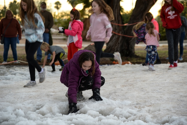 a photo of Kids playing in the snow during a base holiday event.