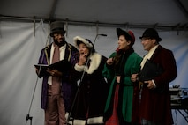 a photo of Singers providing live music during a base holiday event.