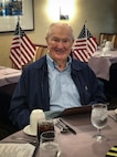 U.S. Marine veteran John Campbell, a World War II pilot and Pearl Harbor survivor awaits his lunch during a Veterans Day Luncheon at La Vida Del Mar in Solana Beach, California, Dec. 6.