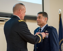 Brig. Gen. Warren Hurst (right), Kentucky's outgoing assistant adjutant general for Air, is pinned with the Kentucky Distinguished Service Medal by Army Maj. Gen. Stephen Hogan, Kentucky's adjutant general, during Hurst's retirement ceremony at the Kentucky Air National Guard Base in Louisville, Ky., Nov. 16, 2019. Hurst is retiring after more than 34 years of service to the active-duty Air Force and Kentucky Air National Guard. (U.S. Air National Guard photo by Staff Sgt. Joshua Horton)