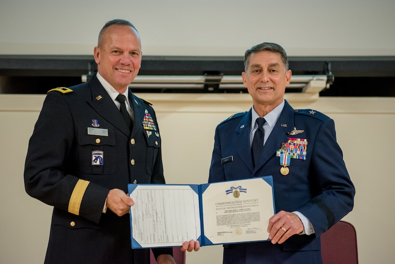 Brig. Gen. Warren Hurst (right), Kentucky's outgoing assistant adjutant general for Air, receives the Kentucky Distinguished Service Medal from Army Maj. Gen. Stephen Hogan, Kentucky's adjutant general, during Hurst's retirement ceremony at the Kentucky Air National Guard Base in Louisville, Ky., Nov. 16, 2019. Hurst is retiring after more than 34 years of service to the active-duty Air Force and Kentucky Air National Guard. (U.S. Air National Guard photo by Staff Sgt. Joshua Horton)