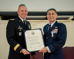 Brig. Gen. Warren Hurst (right), Kentucky's outgoing assistant adjutant general for Air, receives his certificate of retirement from Army Maj. Gen. Stephen Hogan, Kentucky's adjutant general, during Hurst's retirement ceremony at the Kentucky Air National Guard Base in Louisville, Ky., Nov. 16, 2019. Hurst is retiring after more than 34 years of service to the active-duty Air Force and Kentucky Air National Guard. (U.S. Air National Guard photo by Staff Sgt. Joshua Horton)