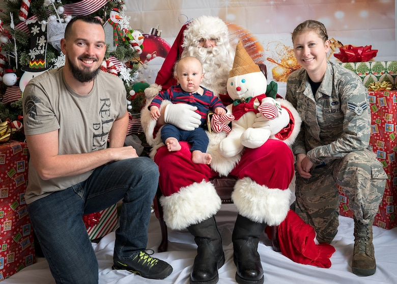 The Sexton family participates in the Airman and Family Readiness Center's Sensory Santa at Barksdale Air Force Base, La., Dec. 6, 2019. The event is specifically for Exceptional Family Member Program families to celebrate the holidays in a sensory-friendly atmosphere. (U.S. Air Force photo by Staff Sgt. Philip Bryant)