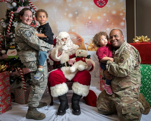 The Bracy family participates in the Airman and Family Readiness Center's Sensory Santa at Barksdale Air Force Base, La., Dec. 6, 2019. The event is specifically for Exceptional Family Member Program families to celebrate the holidays in a sensory-friendly atmosphere. (U.S. Air Force photo by Staff Sgt. Philip Bryant)
