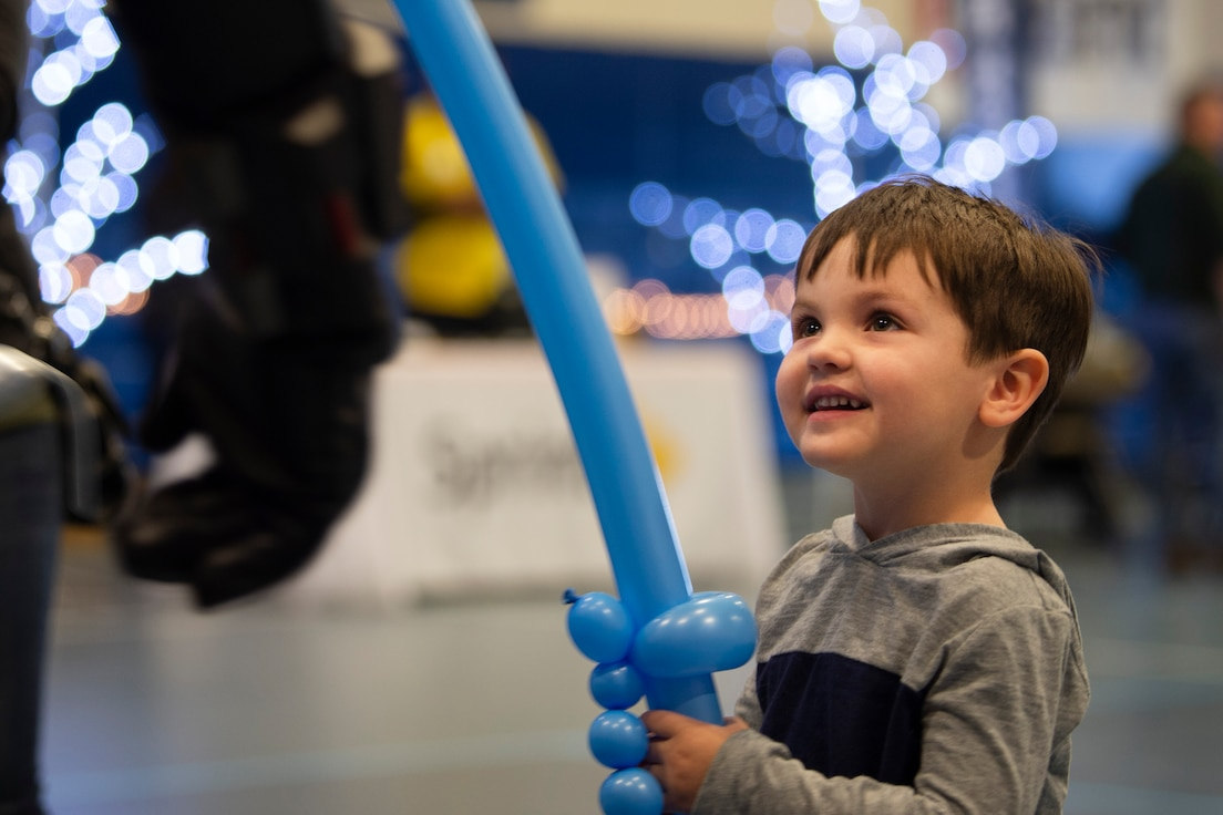Lucas, 3, plays with a balloon sword at the annual Children's Holiday Fest at Schriever Air Force Base, Colorado, Dec. 7, 2019. At the event, children received free balloon crafts, hot chocolate and cookies courtesy of the 50th Force Support Squadron. (U.S. Air Force photo by Airman 1st Class Jonathan Whitely)