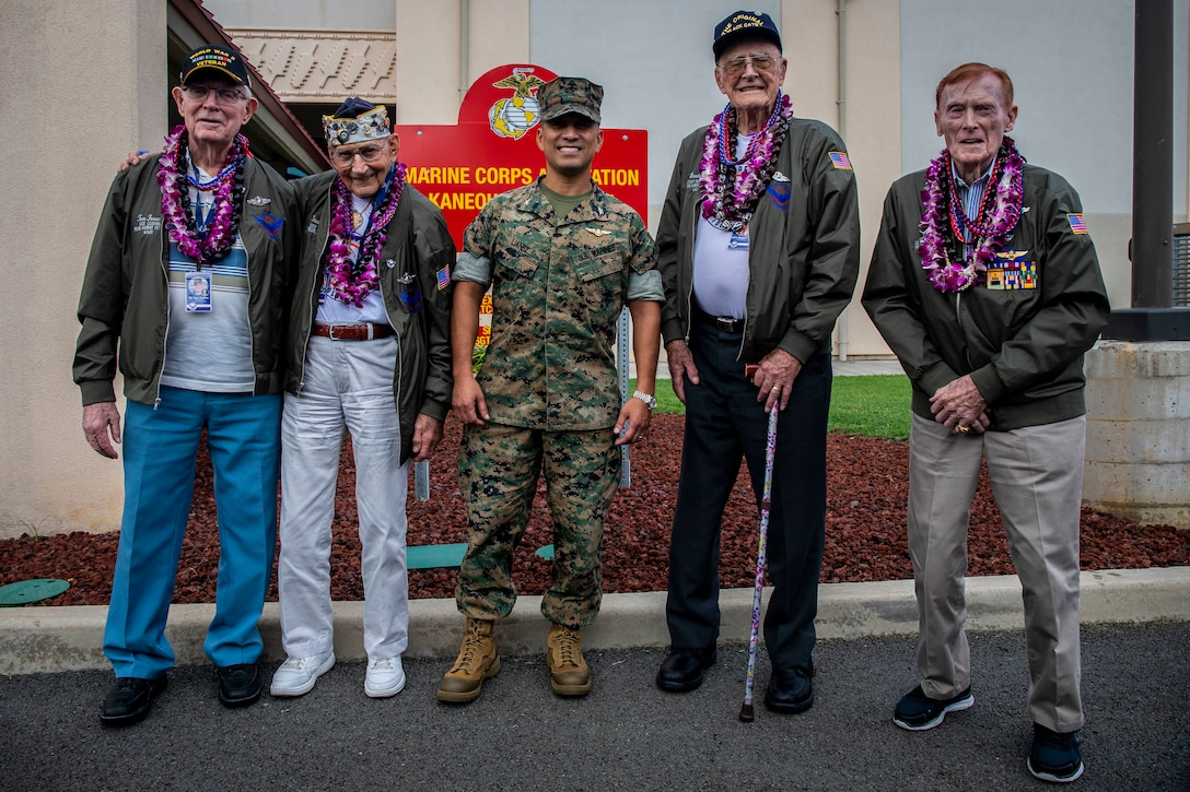 U.S. Marine Corps Col. Raul Lianez, commanding officer, Marine Corps Base Hawaii and U.S. Navy veterans pose for a group photo during the their visit, MCBH, Dec. 5, 2019. The Best Defense Foundation returned 6 WWII Pearl Harbor and Naval Air Station Kaneohe Bay survivors to Hawaii for the 78th Commemoration of Pearl Harbor and Naval Air Station Kaneohe Bay which is now MCBH. The heroes returned were Jack Holder US NAVY - Naval Air Station, Kaneohe Bay; Tom Foreman US Navy - USS Cushing; Ira Schab US Navy - USS Dobbin; Stuart Hedley US Navy - USS West Virginia; Donald Long US Navy - Naval Air Station, Kaneohe Bay; and Chuck Kohler US Navy - USS Hornet.