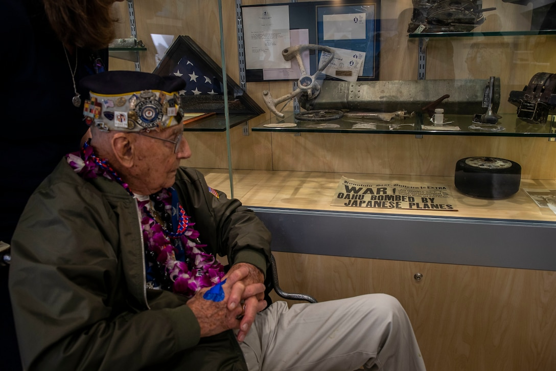 Stuart Hedley, retired U.S. Navy gun pointer, looks at a newspaper during his visit, Marine Corps Base Hawaii, Dec. 5, 2019. The Best Defense Foundation returned 6 WWII Pearl Harbor and Naval Air Station Kaneohe Bay survivors to Hawaii for the 78th Commemoration of Pearl Harbor and Naval Air Station Kaneohe Bay which is now MCBH. The heroes returned were Jack Holder US NAVY - Naval Air Station, Kaneohe Bay; Tom Foreman US Navy - USS Cushing; Ira Schab US Navy - USS Dobbin; Stuart Hedley US Navy - USS West Virginia; Donald Long US Navy - Naval Air Station, Kaneohe Bay; and Chuck Kohler US Navy - USS Hornet.