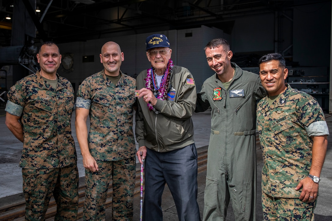 Donald Long, retired U.S. Navy radio operator, and U.S. Marines pose for a group photo during his visit, Marine Corps Base Hawaii, Dec. 5, 2019. The Best Defense Foundation returned 6 WWII Pearl Harbor and Naval Air Station Kaneohe Bay survivors to Hawaii for the 78th Commemoration of Pearl Harbor and Naval Air Station Kaneohe Bay which is now MCBH. The heroes returned were Jack Holder US NAVY - Naval Air Station, Kaneohe Bay; Tom Foreman US Navy - USS Cushing; Ira Schab US Navy - USS Dobbin; Stuart Hedley US Navy - USS West Virginia; Donald Long US Navy - Naval Air Station, Kaneohe Bay; and Chuck Kohler US Navy - USS Hornet.