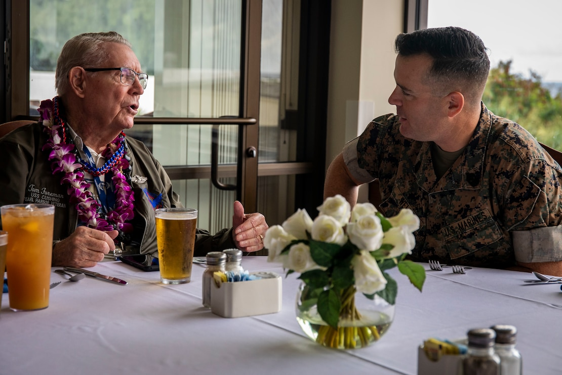 Tom Foreman, retired U.S. Navy gun director, speaks to U.S. Marine Corps Sgt. Maj. Charles Wells, sergeant major, Marine Corps Base Hawaii, during his visit, MCBH, Dec. 5, 2019. The Best Defense Foundation returned 6 WWII Pearl Harbor and Naval Air Station Kaneohe Bay survivors to Hawaii for the 78th Commemoration of Pearl Harbor and Naval Air Station Kaneohe Bay which is now MCBH. The heroes returned were Jack Holder US NAVY - Naval Air Station, Kaneohe Bay; Tom Foreman US Navy - USS Cushing; Ira Schab US Navy - USS Dobbin; Stuart Hedley US Navy - USS West Virginia; Donald Long US Navy - Naval Air Station, Kaneohe Bay; and Chuck Kohler US Navy - USS Hornet.