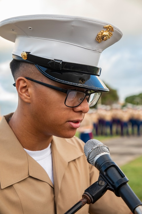 U.S. Marine Corps LCpl. Jacob Dilata, Marine Corps Air Station Kaneohe Bay, narrates during the annual Klipper Ceremony, Marine Corps Base Hawaii, Dec. 7, 2019. The Klipper Memorial was dedicated in 1981 to honor the 17 U.S. Navy Sailors and two civilian contractors who died during the attack on Naval Air Station Kaneohe Bay on Dec. 7, 1941.