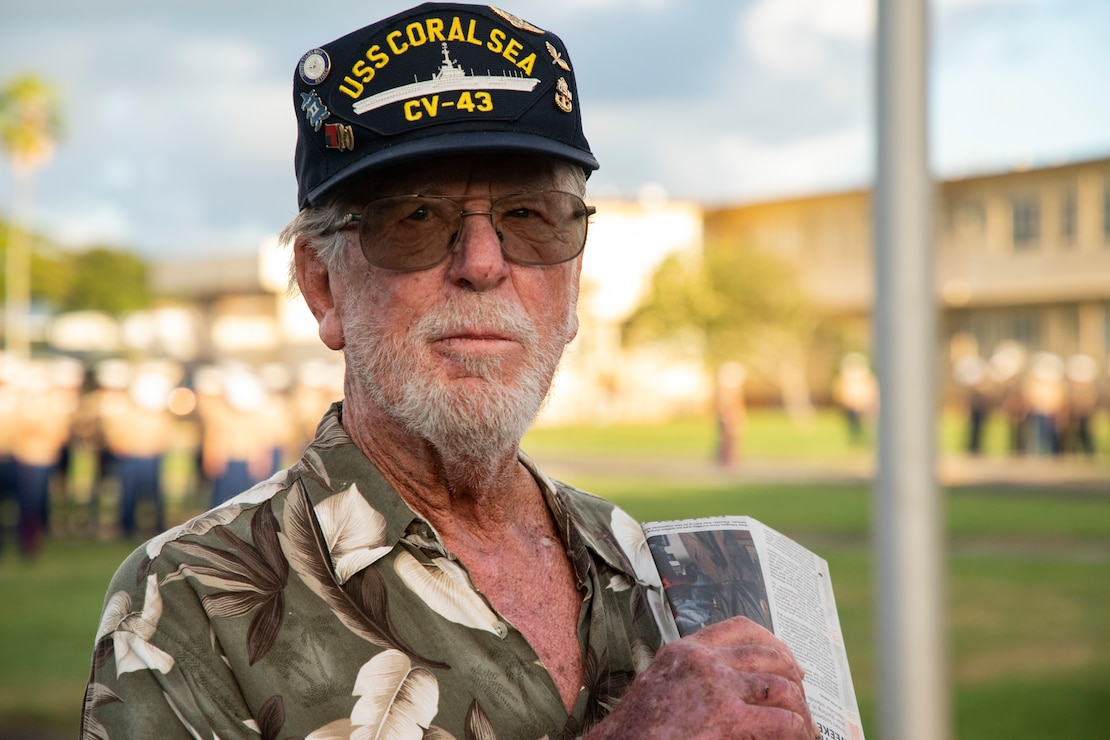 Mr. Daniel Griffin, a veteran whose father was present during the attack on Naval Air Station Kaneohe Bay, speaks with Marines before the annual Klipper Ceremony, Marine Corps Base Hawaii, Dec. 7, 2019. The Klipper Memorial was dedicated in 1981 to honor the 17 U.S. Navy Sailors and two civilian contractors who died during the attack on Naval Air Station Kaneohe Bay on Dec. 7, 1941.