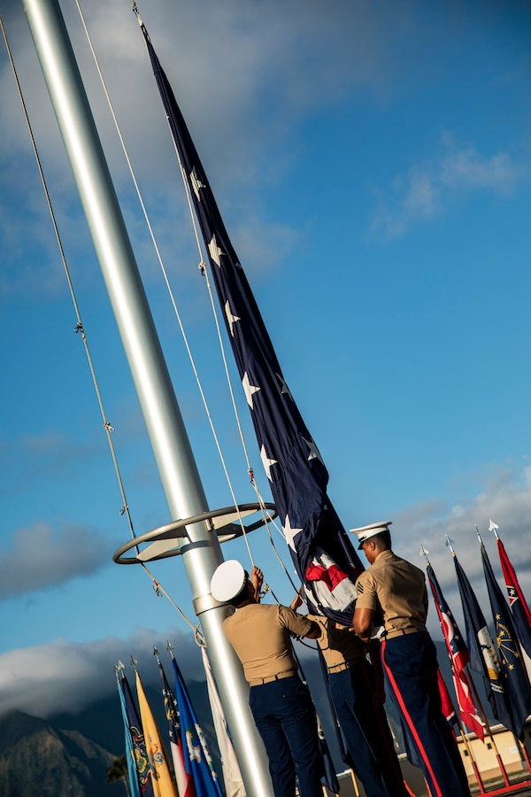 U.S. Marines with the Headquarters Battalion color guard hoist the colors during the annual Klipper Ceremony, Marine Corps Base Hawaii, Dec. 7, 2019. The Klipper Memorial was dedicated in 1981 to honor the 17 U.S. Navy Sailors and two civilian contractors who died during the attack on Naval Air Station Kaneohe Bay on Dec. 7, 1941.