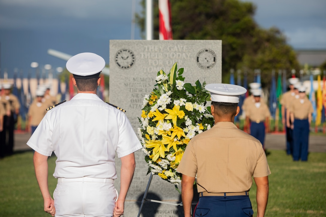 U.S. Marine Corps Col. Raul Lianez, commanding officer, Marine Corps Base Hawaii, places a wreath at the Klipper Memorial with CDR Steve Niemann, officer in charge, Naval Support Detachment, during the Klipper Ceremony, Marine Corps Base Hawaii, Dec. 7, 2019. The Klipper Memorial was dedicated in 1981 to honor the 17 U.S. Navy Sailors and two civilian contractors who died during the attack on Naval Air Station Kaneohe Bay on Dec. 7, 1941.
