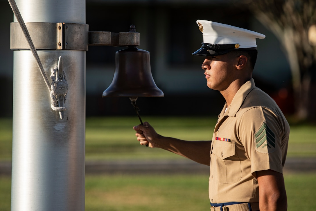 A U.S. Marine rings a bell for those who gave their lives on Dec. 7, 1941, during the Annual Klipper Ceremony held at Marine Corps Base Hawaii, Dec. 7, 2019. The Klipper Memorial was dedicated in 1981 to honor the 17 U.S. Navy Sailors and two civilian contractors who died during the attack on Naval Air Station Kaneohe Bay on Dec. 7, 1941.