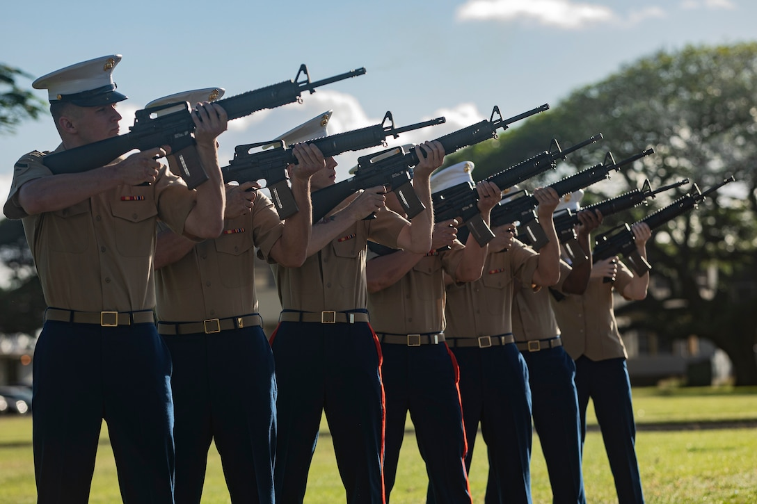 U.S. Marines with the rifle detail for the annual Klipper Ceremony perform the traditional 21-gun salute for those who gave their lives on Dec. 7, 1941, Marine Corps Base Hawaii, Dec. 7, 2019. The Klipper Memorial was dedicated in 1981 to honor the 17 U.S. Navy Sailors and two civilian contractors who died during the attack on Naval Air Station Kaneohe Bay on Dec. 7, 1941.